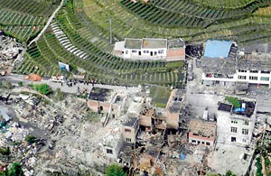 An aerial view shows houses damaged after a strong earthquake in Lushan county, Ya'an, Sichuan province (REUTERS)