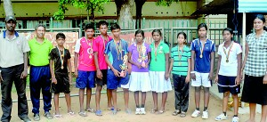 The victorious Jaffna men and women table tennis players with their awards and medals from the District Championship