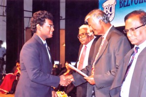 Aniston A Mariyanayagam receiving his Scholarship for the High Achievement at IGCSE 2012 from the Chief Guest Prof.M.Ubayasiri de Silva at the Prize Giving 2013