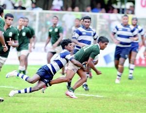 A Josephian defender tries to bring down an Isipathana three-quarter at Longdon Place.          - Pic by Ranjith Perera