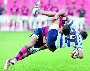 CR&FC 'A' player Piyum Jayasinghe brings down an Air Force 'B' player in their game - Pic by Amila Gamage