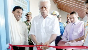 Founder of the Thinakurral newspaper, S.P. Samy cutting the ribbon.  Pix by  T. Premananth