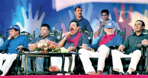 A tired President Mahinda Rajapaksa with other grim faced SLFP stalwarts at Campbell Park. Pic by Amila Gamage