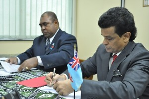 Seen here Mr. Parakrama Dissanayake (right) signing the agreement.
