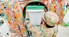 Pakistan votes in landmark polls, attacks kill 18