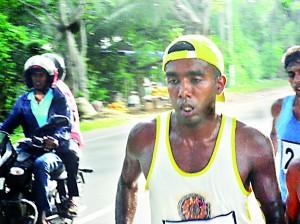 Asela Bandara the winner of the half marathon at the half way mark