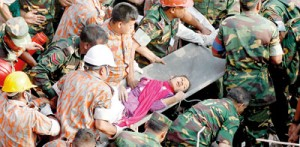 Bangladeshi rescuers retrieve worker Reshma from the rubble of a collapsed building in Savar on May 10, seventeen days after the building collapsed (AFP)