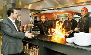 Dishing it all up: Faiz Basheer has a word with his chefs. Pix by Susantha Liyanawatte