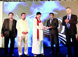 Picture shows Association President Indika Sampath Merenchige handing over the first copy of the directory to Economic Development Minister Basil Rajapaksa.
