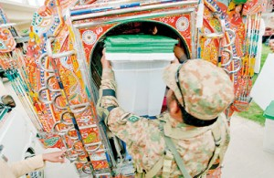 A Pakistani army soldier loads ballot boxes into a van at the  distribution point in Rawalpindi on May 10 (AFP)