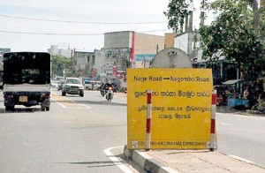 These two boards sit almost at the turn-off itself and cause a build-up of traffic as drivers struggle to make the detour to turn onto the Negombo road