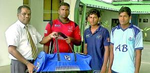 SLC's Kamal Dharmasiri handing over the cricket gear to Sanjeewan (L), Tudor (centre) and Silojan (R).