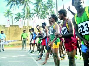 Sugath Madugalla flags off the mens half marathon at Midigama