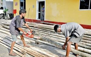 Getting ready to put up a pandal in Kirulapone. Pix by Susantha Liyanawatte