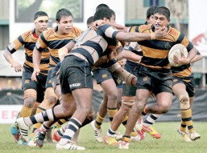 A Royal forward, with the ball, tries to make a break but is held back by a Josephian defender. - Pic by Amila Gamage