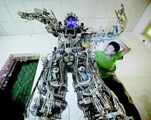 Chinese inventor Tao Xiangli welds a component of his self-made robot (back) at the yard of his house in Beijing, May 15. Tao, 37, spent about 150,000 yuan (USD 24,407 ) and more than 11 months to build the robot out of recycled scrap metals and electric wires that he bought from a second-hand market. The robot is 2.1-metre-tall and around 480 kilograms (529 lbs) in weight, local media reported (Reuters)