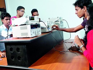 Electrical Engineering Students in a Practical Session