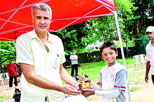 The Man of the Series Rahul Rajesh receiving his award from the Head of Primary and Deputy Principal David Goodwin