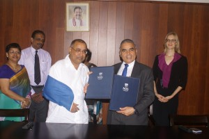 An MoU was signed this week between Singapore's Lee Kuan Yew School of Public Policy and the Finance Ministry for the training of local public sector officials. Seen here is Treasury Secretary Dr P.B. Jayasundera, wearing a shoulder strap due to a dislocated elbow, and Prof. Kishore Mahbubani Dean of the LKY School of Public Policy, National University of Singapore along with senior Ministry officials. (Picture courtesy Finance Ministry)