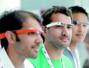 The finished product: Google Glass team members wear Google Glasses at a booth at Google I/O 2013 in San Francisco