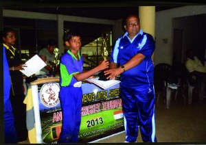 Imtiaz Ahamed CA ……. Under 12 team.Receiving the runner-up trophy from Harsha Peiris, the CEO of the CCC School of Cricket.