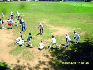 Paul McEwan plays  a game with junior cricketers of St Thomas' College Matara