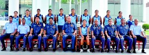 The SLAF women's volleyball team with officials.