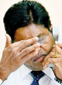 CEB Chairman: Price hike appears to lie heavily on his head.  Pic by Hasitha Kulasekera