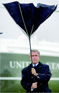 "Umbrella issues: Obama is not the first US president to have problems in a bid to stay dry. George W. Bush ""battles"" with his umbrella after stepping off Marine One at Andrews Air Force Base in 2004 (AFP)"