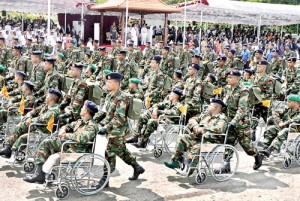 Disabled soldiers on wheel chairs taking part in yesterday's Victory Day parade at the Galle Face Green in Colombo. President Mahinda Rajapaksa was the chief guest. Pic by Indika Handuwala