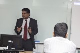 """Ravi Jayewardene deliveres lecture on """"How to Convert Knowledge into Practice at  """"Aventis School of Management"""" in Singapore"""