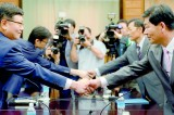 Two Koreas hold rare talks on joint zone