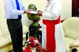 Book presented to Archbishop of Colombo