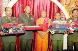 Army's 37 regimental flags blessed inside  Sri Dalada Maligawa's inner shrine room