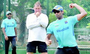 Marvan Atapattu and one of the foreign coaches who presided over Lankan cricket - Geoff March - watching the Sri Lankan players at nets. - File pic