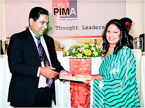 Ms. Shashi Praba of Vidullanka PLC receiving her certificate being the 1st in Merit from the Chief Guest  Mr. Thushara  Perera, Group  Director Marketing ,  Derana