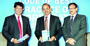 Picture shows the new Code of Best Practice on Corporate Governance being presented to Dr  Nalaka Godahewa, Chairmasn SEC and Sujeewa Rajapakse, President CA Sri Lanka by Asite Talwatte, co-chairman Corporate Governance Committee.