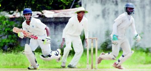 Nimesha Munasinghe of St. Anthony's desperately tries to make a run duirng his side's meagre first innings reply of 99 against Wesley's 175 at Campbell Park. 		 - Pic by Amila Gamage