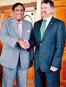 Hungarian Parliament Speaker Laszlo Kover greets Mr. Nanayakkara