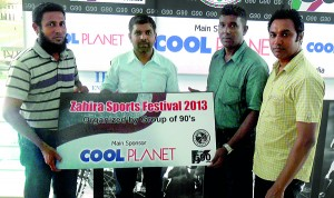 Mohamed Aslam (Left), Accountant of Cool Planet, the Main sponsor handing over the sponsorship cheque to M.R.M. Razak (second from right), Project Chairman of the Sports Festival 2013. Also in the picture from left are Sharan Laffir, President, Group of 90s and M. Shiraz, the Secretary.
