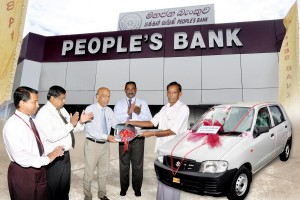 Picture shows Mr. V. Karuppaiah receiving the Susuki Car Alto from Mr. P. Sirisena People's Bank Badulla Regional Manager. Assistant Regional Managers Mr. R.M. Ranbanda and Mr. K.P.S.L.Samarathunga and Mr. Manjula Dissanayake – Haputale Branch Manager are also present.