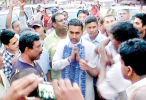 Prime Minister D.M. Jayaratne's son Anuradha greeting his supporters at the Kandy demonstration where his supporters insisted that he be made the chief minister