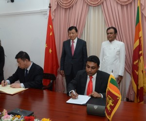 Picture shows Managing Director of Sri Lanka Tourism Promotion Bureau Rumy Jauffer and the Chief Editor of China Central Television Luo Ming signing the agreement.