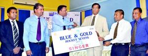Royal College Principal Upali Gunasekara receiving the Singer sponsorship               - Pic by Hasitha Kulasekera