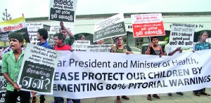 At a recent demonstration in Colombo, protesters calling for big pictorial warnings on packets of cigaretters