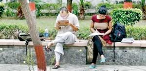 Indian students study inside the Delhi University campus in New Delhi (REUTERS)