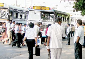 Passengers rush to enter a bus which had stopped at a pedestrian crossing