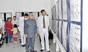 Royal Principal Upali Gunasekara and Mr. Weeraman looking at the exhibits