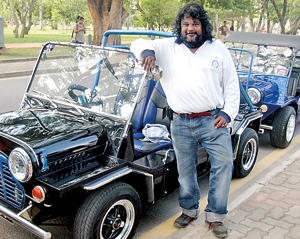Cars that make people smile: Dr. Kesara Serasinghe  with his S. Thomas themed Mini Moke