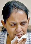 Lilani: Tears for a dead husband.  Pic by M.A. Hasitha Kulasekera